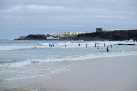Surfen an der Playa del Castillo (mit Blick auf das Castillo)
